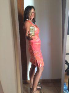 Fiona-Robertson-Body Renewer-Inside-Job-orange-dress