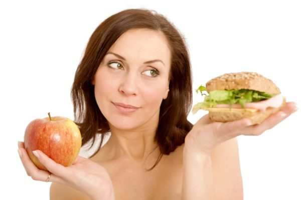 Peace-With-Food- Body-Renewer-Food-choices-no-food-is-a-sin-woman-choosing-apple-or-burger