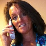Fiona-Robertson-Body-Whisperer-Coach-on-the-telephone