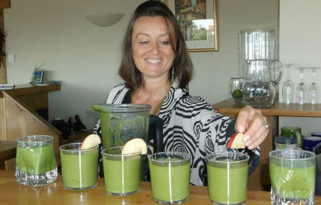 Home-Detox-Box-and-home-retreat-Woman-serving-green-juices