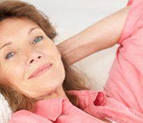 Woman-winning-the-world-relaxed-wearing-a-pink-shirt